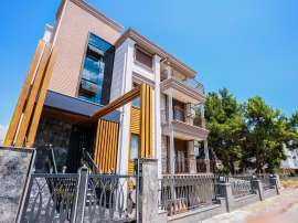 Luxury apartments in a renovated house in the prestigious Altinkum area, Konyaalti near the beach