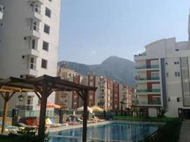Resale apartment in Sarisu, Konyaalti in a complex with a swimming pool - 39014   Tolerance Homes