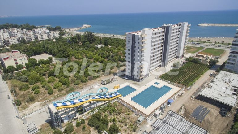 Spacious apartments in Erdemli, Mersin in a complex with a swimming pool and a water slides next to the sea - 42673 | Tolerance Homes