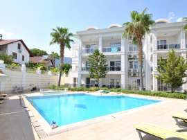 Resale apartment in the center of Kemer in a complex with a swimming pool near the sea - 42700 | Tolerance Homes