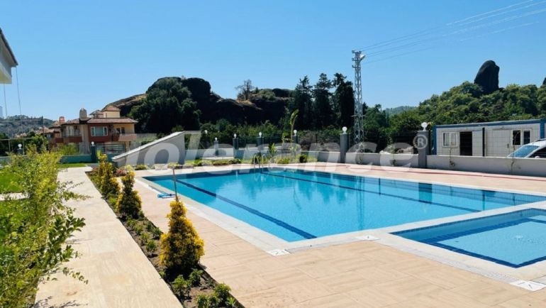Cheap apartments in Kuzdere, Kemer in a complex with a swimming pool from the developer - 43580 | Tolerance Homes