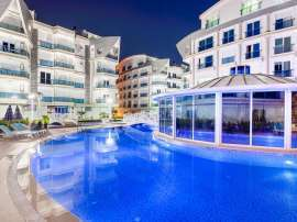 Apartment complex in Liman, Konyaalti luxury hotel type with a large swimming pool and rental guarantee - 586   Tolerance Homes