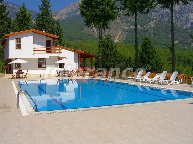 Cozy townhouses in Beycik, Kemer in a complex with a swimming pool among relict pine trees - 32101 | Tolerance Homes