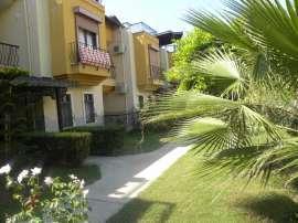 Three cheap townhouses in a splendid complex in Okurcalar