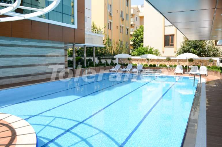 Apartments in Konyaaltı, Antalya with a full set of furniture and appliances 100 meters from the sea - 4043 | Tolerance Homes
